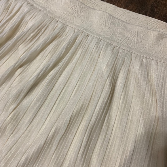 Dresses & Skirts - A-line midi pleated skirt. Ivory or cream colored